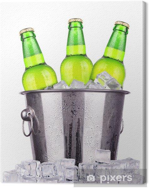 Tableau sur toile Les bouteilles de bière dans un seau de glace isolés - Alcool