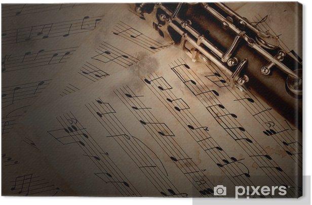 Tableau sur toile Les notes de musique et la clarinette sur table en bois - Musique