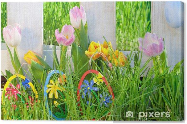 Tableau sur toile Les oeufs de Pâques à la clôture du jardin ...