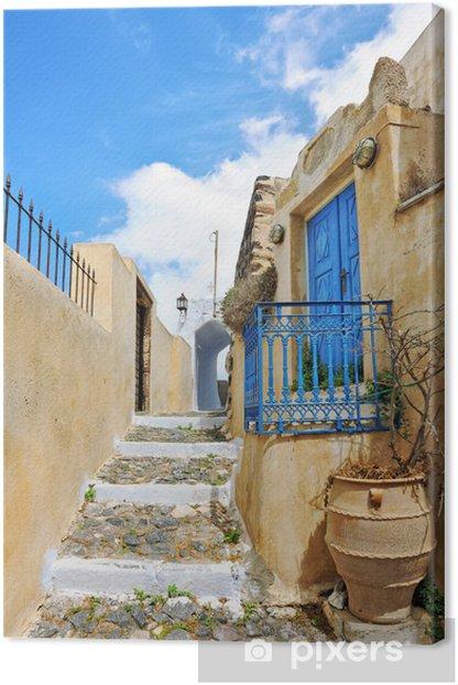 Tableau sur toile Maison avec porte bleue et garde-corps dans une ruelle à Pyrgos - Thèmes
