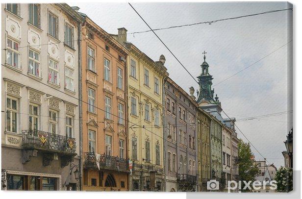 Tableau sur toile Maisons sur une place de marché à Lviv - Europe