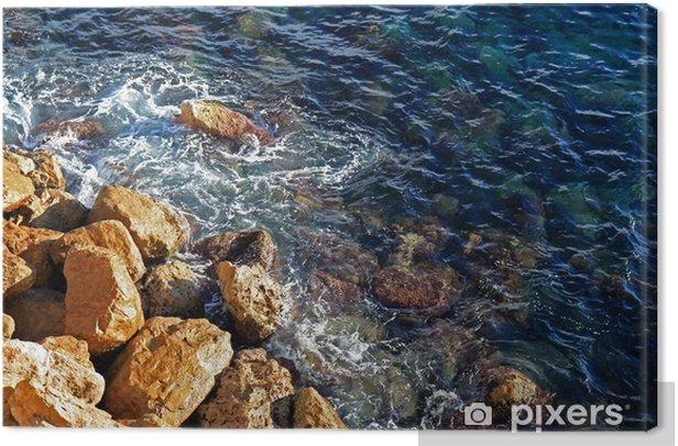 Tableau sur toile Martèlement des vagues contre les rochers côtiers - Eau