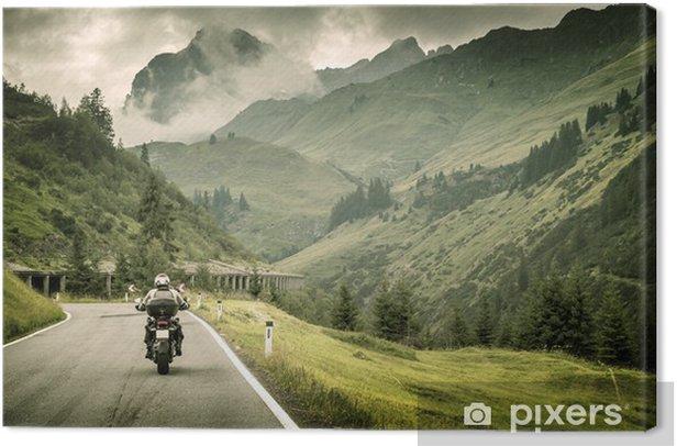 Tableau sur toile Motocycliste sur route montagneuse - Europe