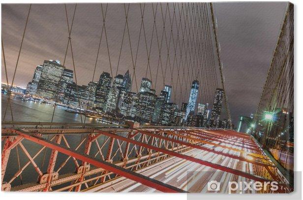Tableau sur toile New York - Manhattan Skyline du pont de Brooklyn par nuit - Thèmes
