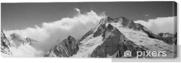Tableau sur toile Panorama de montagne noir et blanc dans les nuages - Landscapes