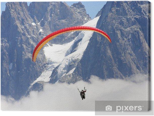Tableau sur toile Parapente au dessus des nuages et des glaciers - Sports extrêmes