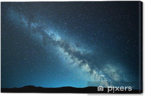 Tableau sur toile Paysage de nuit avec une voie lactée incroyable à la montagne. ciel étoilé bleu nuit avec des collines en été. belle galaxie. univers. fond de l'espace - Paysages