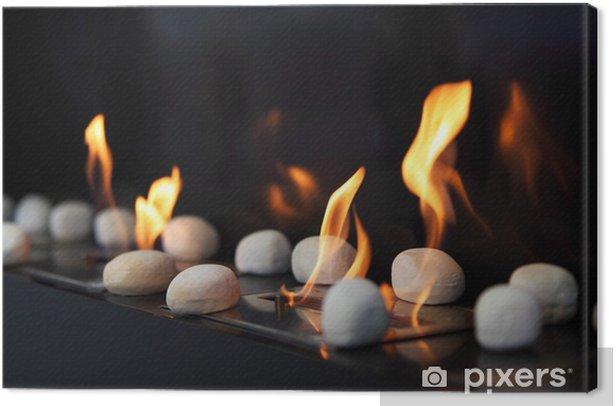 Tableau sur toile Pierres blanches circulaires et de belles flammes jaunes cheminée - Textures