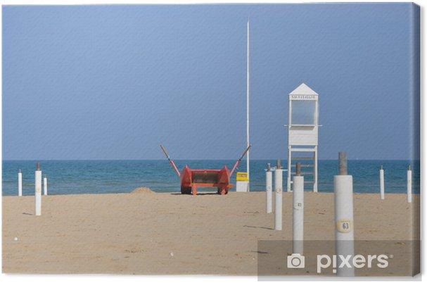 Tableau sur toile Plage vide avec la tour de garde et le bateau de sauvetage à Rimini - Europe