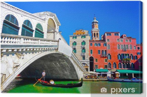 Tableau sur toile Pont du Rialto célèbre avec gondole à Venise, Italie - Villes européennes