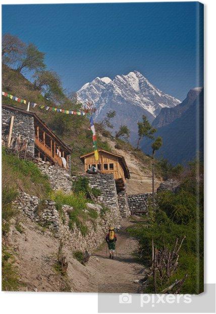 Tableau sur toile Randonneur dans le village de l'Himalaya - Thèmes