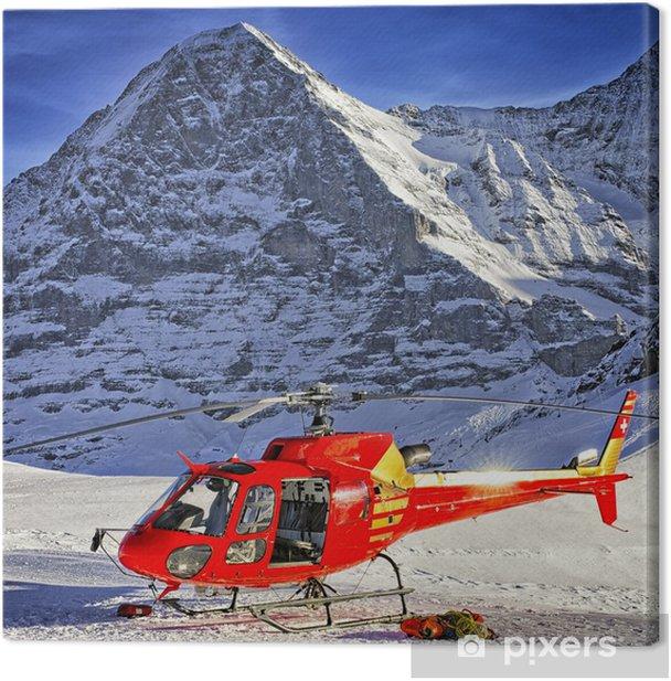 Tableau sur toile Rouge hélicoptère a atterri près de crête alpine près de Jungfrau - Europe
