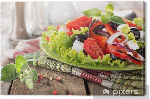 Tableau sur toile Salade de légumes sur une table en bois - Repas