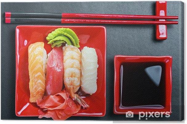 Tableau Sur Toile Seafood Sushi Et Des Baguettes Sur Une Plaque