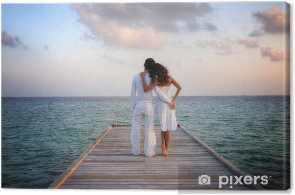 Tableau sur toile Sensual couple heureux dans des vêtements blancs sur un quai (Maldives) - Couples