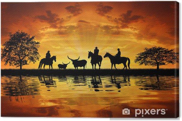 Tableau sur toile Silhouette cow-boys sur des chevaux avec des vaches au coucher du soleil - Mammifères