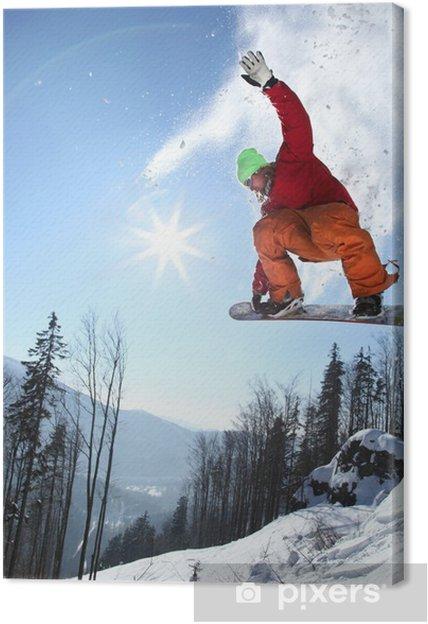 Tableau sur toile Snowboarder sautant contre le ciel bleu - Sports d'hiver