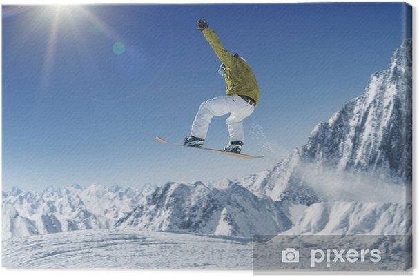 Tableau sur toile Snowboarder sautant dans les montagnes alpines - Hiver