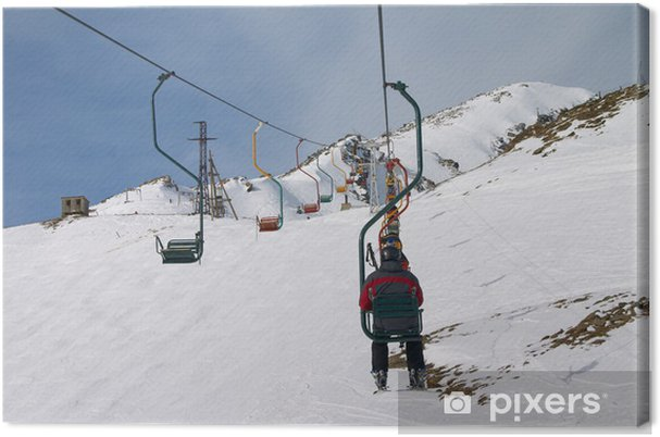 Tableau sur toile Téléski avec les skieurs dans les montagnes du Caucase - Sports d'hiver