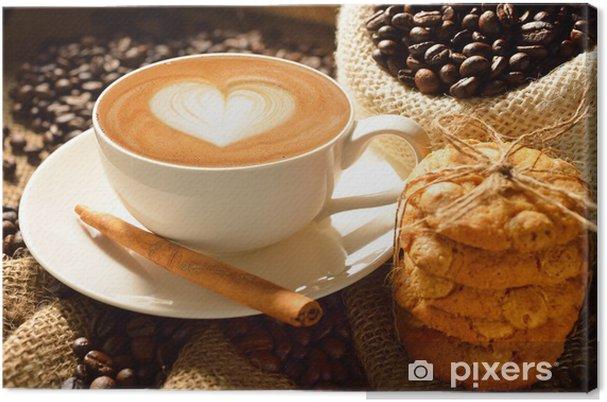 Tableau sur toile Une tasse de café au lait avec des grains de café et des biscuits - Thèmes