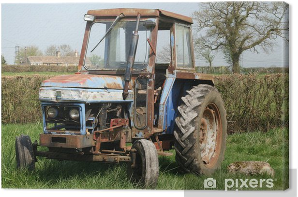 Tableau sur toile Vieux tracteur rouillé dans le champ - Agriculture