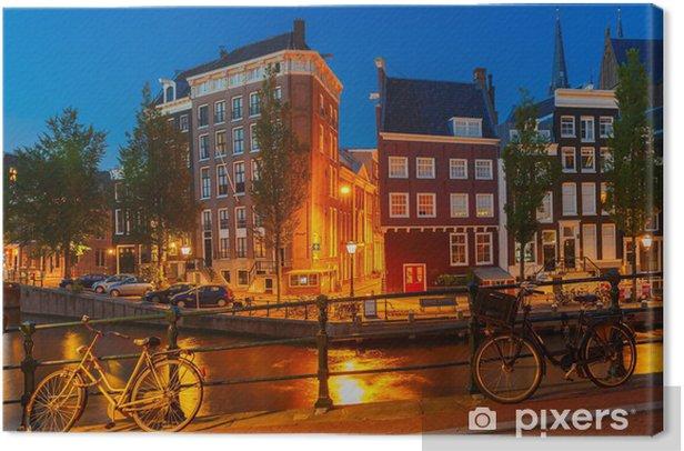 Tableau sur toile Vue nocturne de la ville d'Amsterdam canal et le pont - Villes européennes