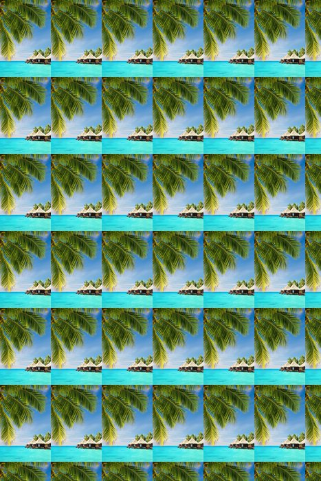 Vinylová Tapeta Kokosová palma listy nad oceánem s bungalovy - Palmy