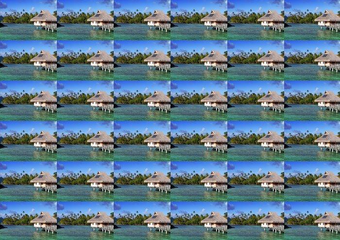 Vinylová Tapeta Pobřeží s palmami a malé domky na vodě. - Prázdniny