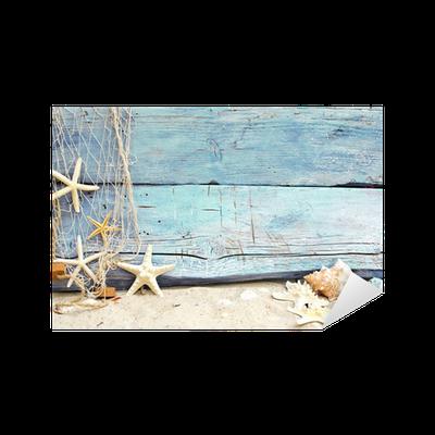 Adesivo flotsam contro un legno blu con rete da pesca for Rete da pesca arredamento