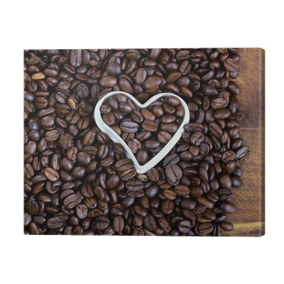 Quadro Su Tela Sfondo Di Chicchi Di Caffè Con Un Cuore Bianco