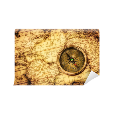 Vintage compass lies on an ancient world map wall mural pixers vintage compass lies on an ancient world map wall mural pixers we live to change gumiabroncs Gallery