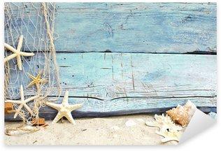 Pixerstick per Tutte le Superfici Flotsam contro un legno blu con rete da pesca