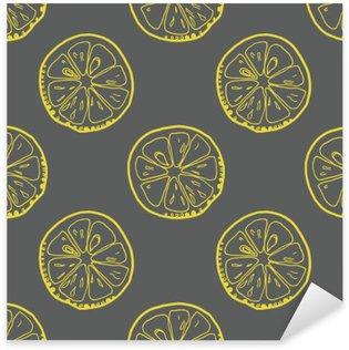 Adesivo Pixerstick Modello con fette di limone su sfondo grigio.