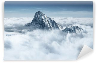 Afwasbaar Fotobehang Bergen in de wolken