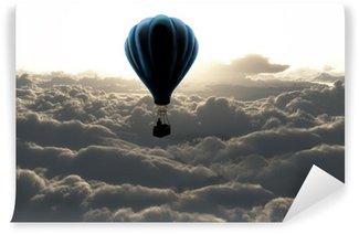 Afwasbaar Fotobehang Luchtballon boven de wolken