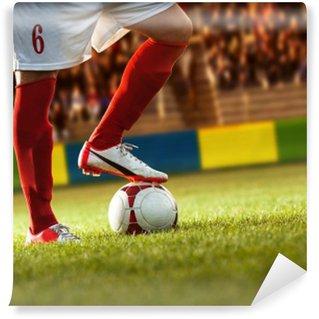 Afwasbaar Fotobehang Voetbalspeler met rode sokken die voorbereidingen treft voor een vrije schop