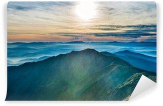 Afwasbaar Fotobehang Zonsondergang in de bergen