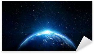 Pixerstick Aufkleber Blau Sonnenaufgang, Blick auf die Erde aus dem Weltraum