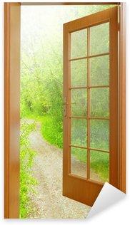 Pixerstick Aufkleber Geöffnete Tür bis zum frühen Morgen im grünen Garten.