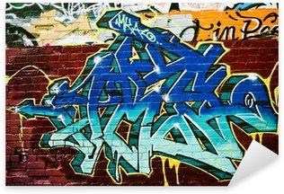 Pixerstick Aufkleber Graffiti Detail auf einem strukturierten Mauer