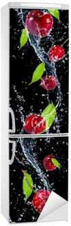 Autocolante para Frigorífico Cherries in water splash, isolated on black background