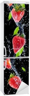 Autocolante para Frigorífico Strawberries in water splash, isolated on black background