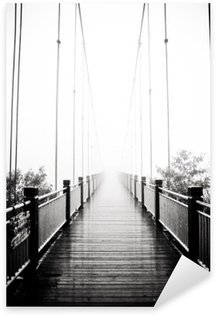 Autocolante Pixerstick view on pedestrian wooden bridge in mist