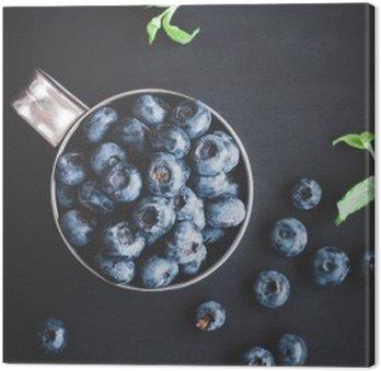 Canvas Blueberry op zwarte achtergrond. Bovenaanzicht, plat