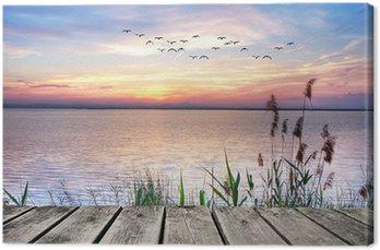 Canvas Een houten steiger bij zonsondergang