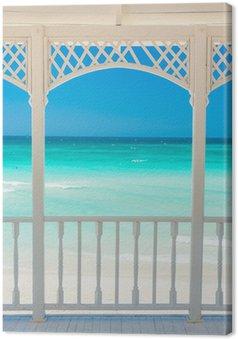 Canvas Houten terras met uitzicht op een tropisch strand in Cuba