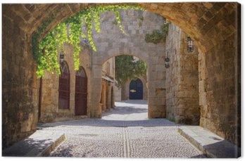 Canvas Middeleeuwse gebogen straat in de oude stad van Rhodos, Griekenland