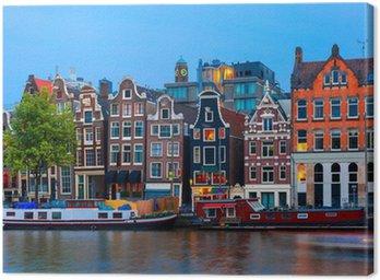 Canvas Nacht uitzicht op de stad van de Amsterdamse gracht met Nederlandse huizen