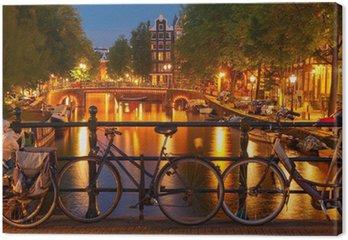 Canvas Nachtverlichting van de Amsterdamse gracht en brug