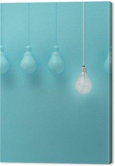Canvas Opknoping gloeilampen met gloeiende een ander idee op lichte blauwe achtergrond, Minimal conceptenidee, plat, top
